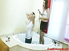 Wetlook girls have shower fully clothed