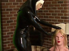 rubber nun poses with female silicone mask