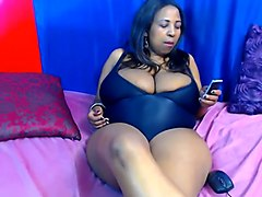 black whore with giant natural boobs playing with big sex toy